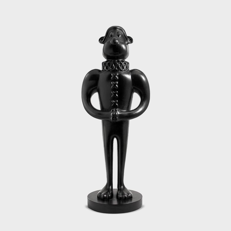 limited edition cartoon dog in african wood carving form. Black polished wood cartoon dog sculpture , Mounted on black polished wood base.