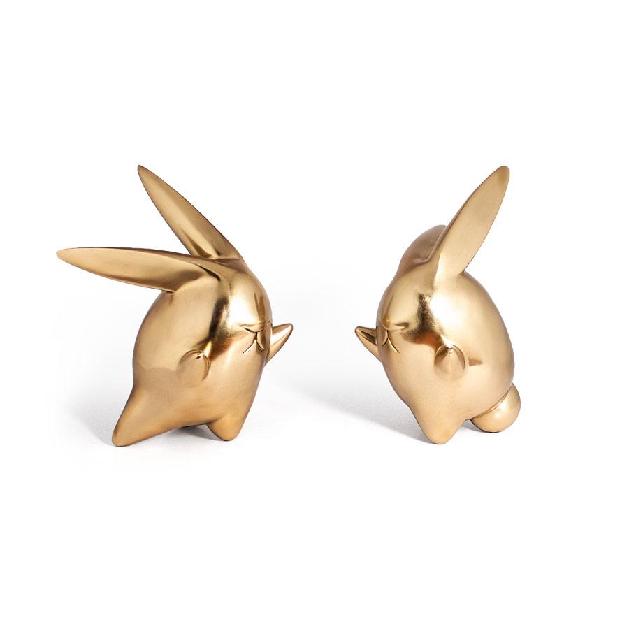 twin bunny bronze sculpture facing each other B Ferdi B Dick